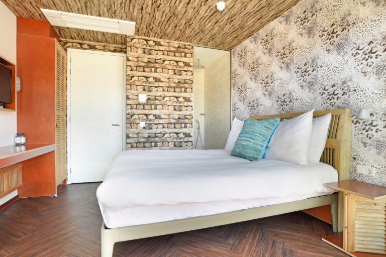 Slaapkamer terras zeezijde kamer Beachhouse hotel